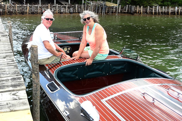 Todd-and-Beth-at-dock-–-no-hoist-first-year;-moored-in-Au-Gres-River.