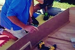 Kids-Build-a-Boat using power tools to assemble boat