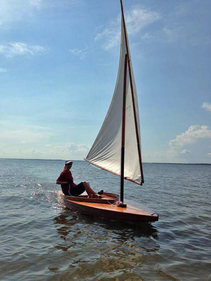 """Audrey Lewis sails """"Zip"""", a 1953 Sunfish Sailboat"""