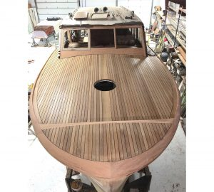 Saving the Class of 47-teak decks installed and mahogany rub rails faired